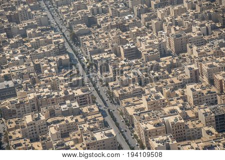 Aerial view of building rooftop and urban street in Tehran capital city of Iran