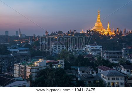 Beautiful illuminated golden Shwedagon pagoda (Shwedagon Zedi Daw) at dawn or twilight time famous landmark and travel destination of Yangon Myanmar (Burma)