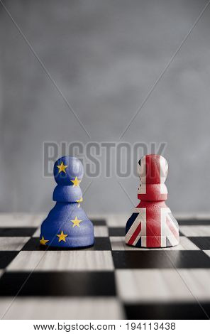 Brexit chess pawns with UK and European flags on a board
