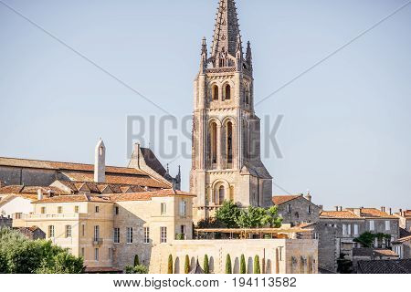 Beautiful cityscape view on Saint Emilion village with church tower in Bordeaux region during the sunset in France