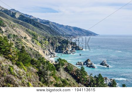 Central California coast with cliffs and blue ocean in Big Sur