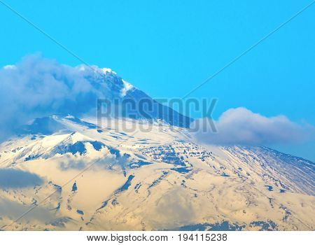 snow Etna mountain smoking steam in Sicily Italy