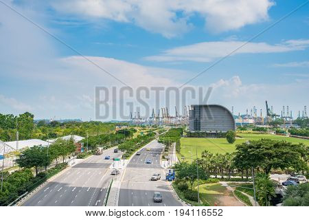 SINGAPORE-JULY 9 2016: Singapore road way near commercial port . It's the world's shipping containers port and global commerce finance and transport logistics in Asia. View from Gardens by the Bay Singapore.
