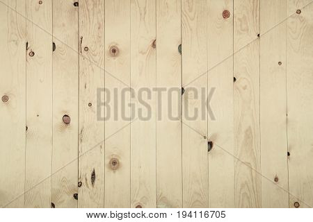 Old grunge beige-brown wood panel pattern with beautiful abstract grain surface texture vertical striped background or backdrop in architectural material decoration concepts vintage or retro style