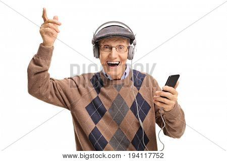 Cheerful senior listening to music on a phone isolated on white background