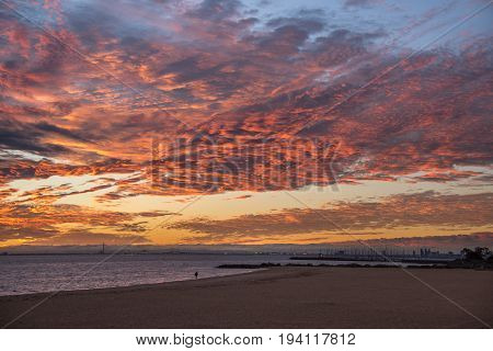 impressive sunset sky with red abstract clouds at Brighton Beach famous place near Melbourne city Australia
