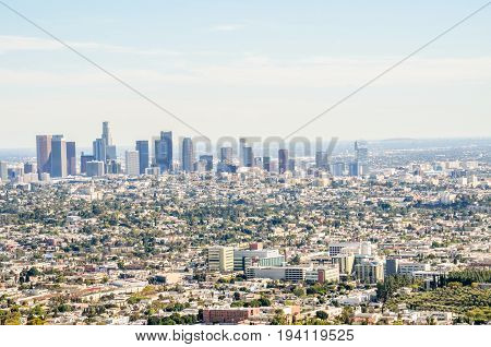 Los Angeles USA - March 9 2014: Cityscape or skyline of LA city with smog during sunrise or sunset