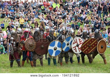 KERNAVE LITHUANIA - JULY 6: Unidentified people in a Medieval fights at International Festival of Experimental Archeology on July 6 2017. Its a most popular folklore event on July in Lithuania