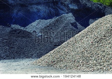 Mountains of different materials extracted from the quarry.