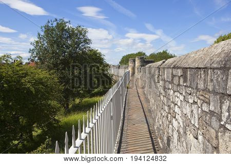 A section of the  medieval walls in in the historic city of York under a blue summer sky
