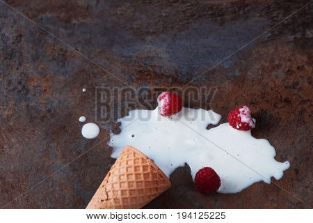 close up of a melting ice cream on brown marble background with copy space