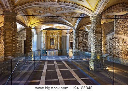 Evora, Portugal - June 12, 2017: Chapel of the Bones (Capela dos Ossos) with human bones and skulls in the wall is one of the best known monuments in Evora Alentejo Portugal
