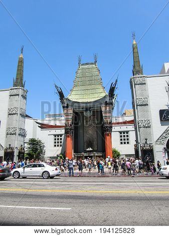 Los Angeles USA - May 25 2010: Grauman's Chinese theater in alley of stars in downtown with people