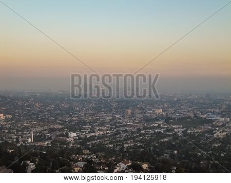 Los Angeles USA - May 24 2010: Cityscape or skyline of the LA city with smog during sunrise or sunset