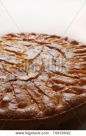 Apple pie detail on white background - Homemade tart