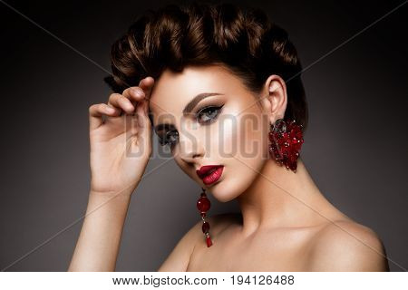 Beauty woman with blue eyes and red lips. Shine skin. Cosmetics.