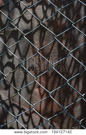Rusty iron surface with chain-link upon it