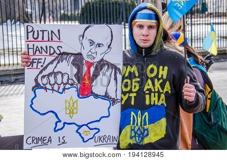 Washington DC USA - March 6 2014: Closeup of man with sign about Russia and Putin during Ukrainian protest by White House