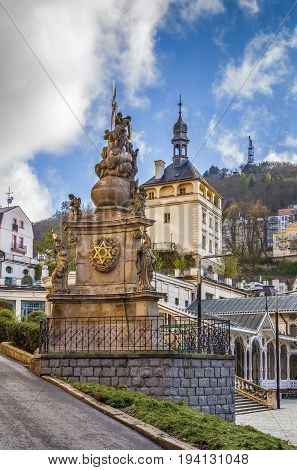 Holy Trinity Column and Castle Tower in Karlovy Vary historic center Czech republic
