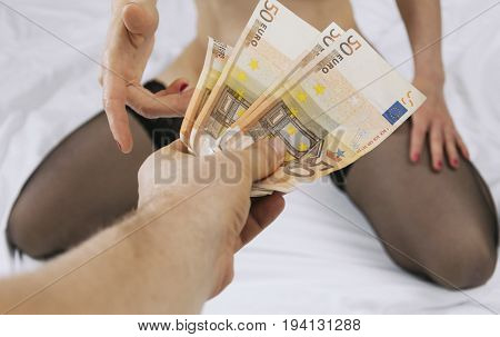 Female prostitute takes money for her work.