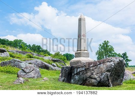 Gettysburg USA - May 24 2017: Little Round Top Grave stone in Gettysburg battlefield national park in forest during summer for Maine Infantry