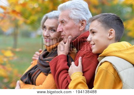 Family portrait of grandparents and grandson outdoors