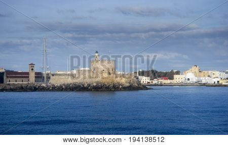 Medieval fortress of Saint Nicholas now the site of a lighthouse in Mandraki Harbour Rhodes Greece