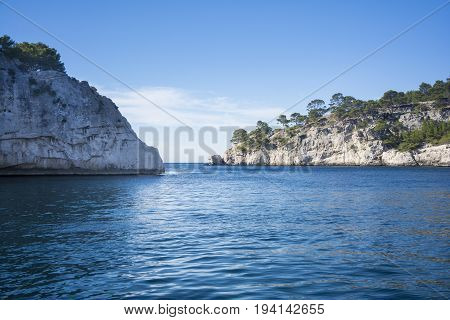 View from the sea of a part of the nature park of the creeks near the French city of Cassis during a sunny day