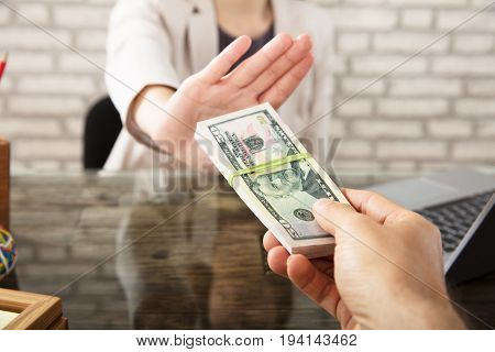 Cropped Hand Of Businesswoman Refusing To Take Bribe From Partner At Workplace