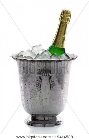 Cold bottle of champagne on ice with white background