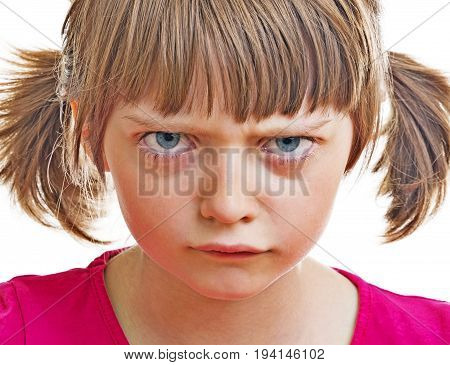 an angry little girl on white background