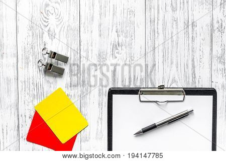 Referee preparing to competition. Yellow and red cards, whistle on wooden background top view.