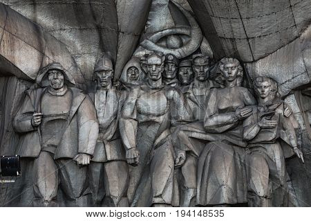 Minsk, Belarus - September 3, 2016: Bas-relief of the Soviet era on old facade building on Nemiga Street in Minsk Belarus
