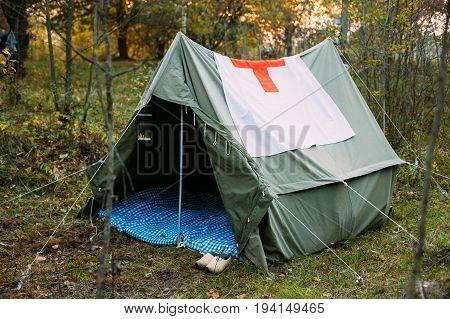 Dyatlovichi, Belarus - October 1, 2016: Camp Tent Of Military Medical Orderlies Of Infantry German Wehrmacht Infantry Soldiers During World War II In Forest Camp Re-enactors.
