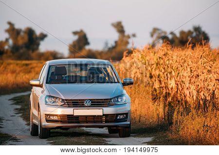Gomel Belarus - September 14, 2016: Volkswagen Polo Vento Car Sedan Parking Near Country Road In Autumn Field In Sunny Evening.