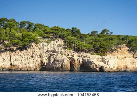 View from the sea of a part of the natural park of the creeks near the French city of Cassis during a sunny day
