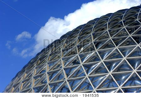 Geodesic dome construction with blue sky and clouds. poster