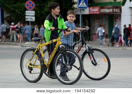 Yoshkar-Ola Russia - June 17 2017 Photo of young cyclists during a bike tour along the streets of Yoshkar-Ola Russia