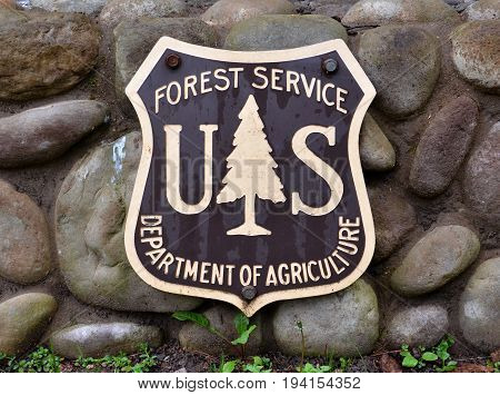 BAY MILLS TOWNSHIP MI - MAY 28: A Forest Service sign in Bay Mills Township MI is shown on May 28 2017. Bayview campground is part of Hiawatha National Forest.