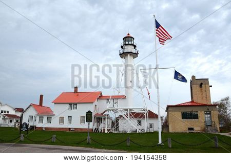 WHITEFISH POINT MI - MAY 28: The lighthouse at Whitefish Point MI is shown on May 28 2017. It is the longest working lighthouse on Lake Superior.