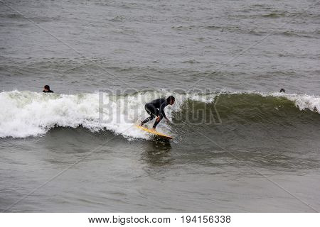 surfer in baltic sea latvia, North pole, liepaja