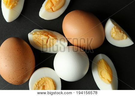 Hard boiled eggs on black background. Nutrition concept