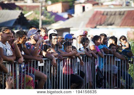 Cluj-Napoca, Romania - 27 June 2017:  Unidentified romani people participating on a charitable concert in the isolated Roma community in Pata Rat, the rubbish dump near Cluj-Napoca, Romania