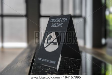 No smoking sign on a shelf of hotel room. Concept photo of banning smoking in public area medical health free smoking hazard and addiction.