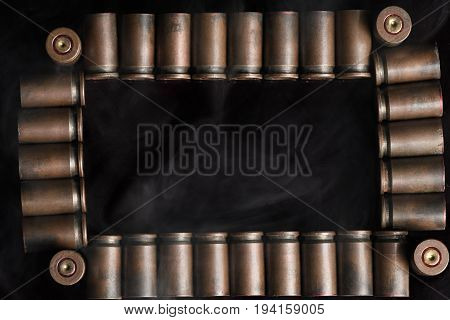 Beautifully Laid Out Shells 9 Mm Pistol In A Frame Filled With Easy Smoke