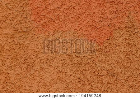 Brown red background of a part of the foundation of a concrete wall of a building