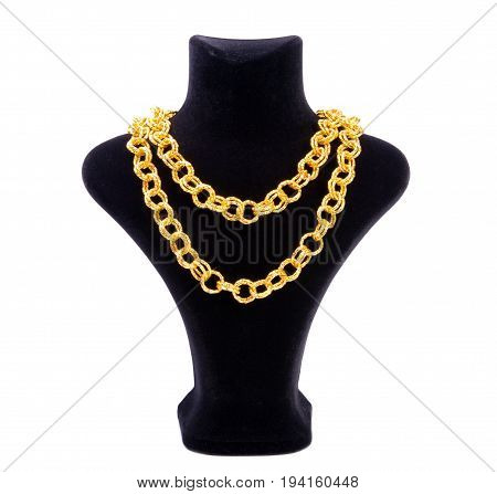 Big golden chain on black mannequin isolated on white background