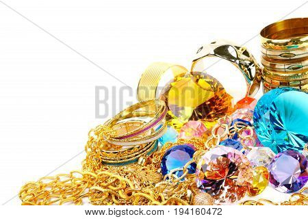 Stock of golden chains  and colorful diamonds, over white background