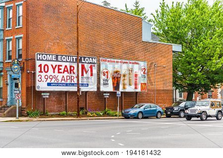 Harrisburg USA - May 24 2017: Pennsylvania capital city brick houses with advertisement in downtown for Home Equity loans