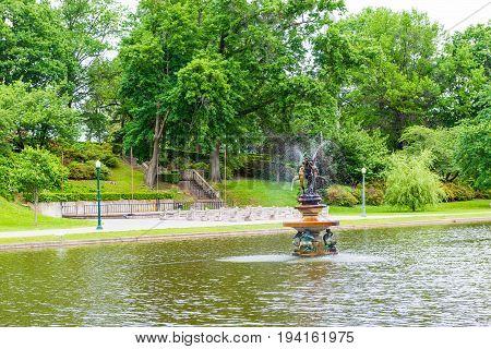 Harrisburg USA - May 24 2017: Italian Lake Park in Pennsylvania capital city with fountain and statue